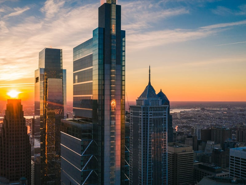 Philadelphia skyline as the sun is setting, featuring the Four Seasons hotel